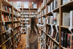 Female browsing books in a library