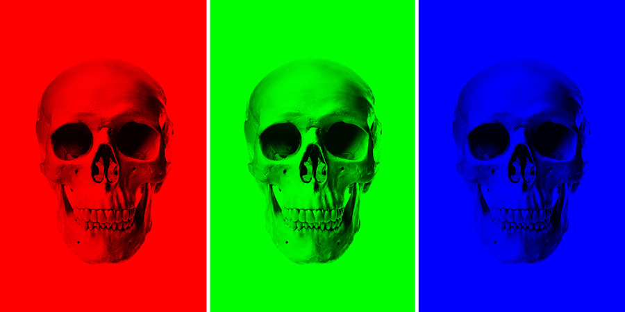 these three skull images have had two channels painted black