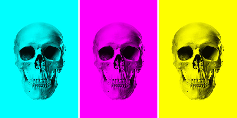 three skulls demonstrating painting black onto each of the Red, Green, and Blue channels