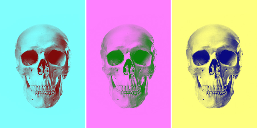 three skulls demonstrating painting grey onto each of the Red, Green, and Blue channels